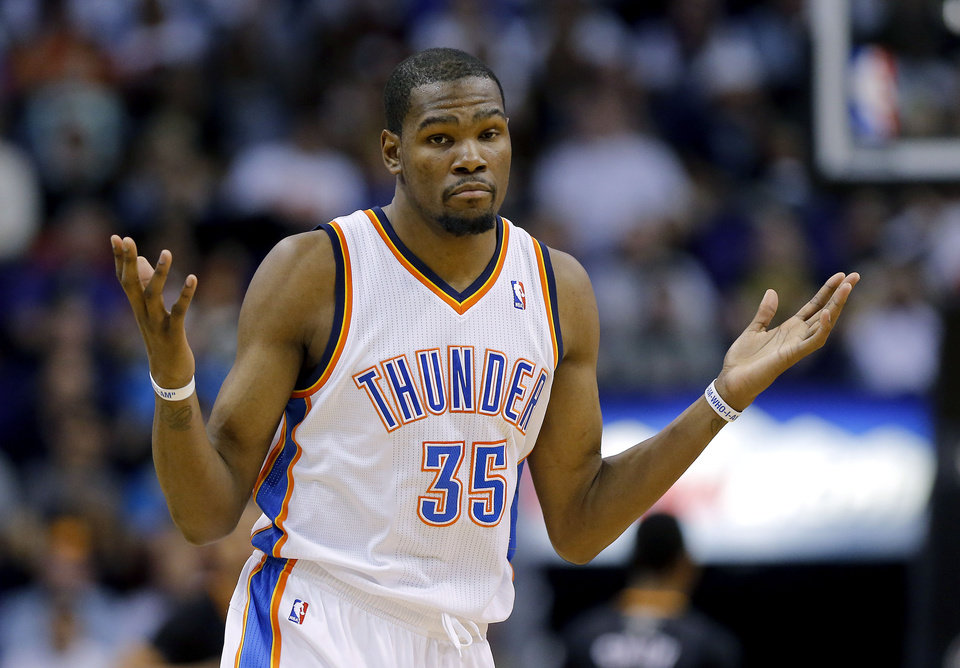 Oklahoma City Thunder forward Kevin Durant reacts to sinking a 3-pointer during the second half of an NBA basketball game against the Phoenix Suns, Thursday, March 6, 2014, in Phoenix. The Suns won 128-122. (AP Photo/Matt York)