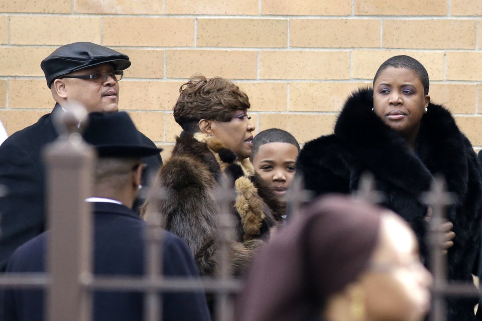 Father Nathaniel Pendleton, left, his son Nathaniel Jr. and mother Cleopatra Pendleton, right, arrive for the funeral of their daughter and sister Hadiya Pendleton at the Greater Harvest Missionary Baptist Church Saturday, Feb. 9, 2013, in Chicago. The shooting death of the 15-year-old honor student has drawn attention to the staggering gun violence in the nation\'s third-largest city. (AP Photo/Nam Y. Huh)