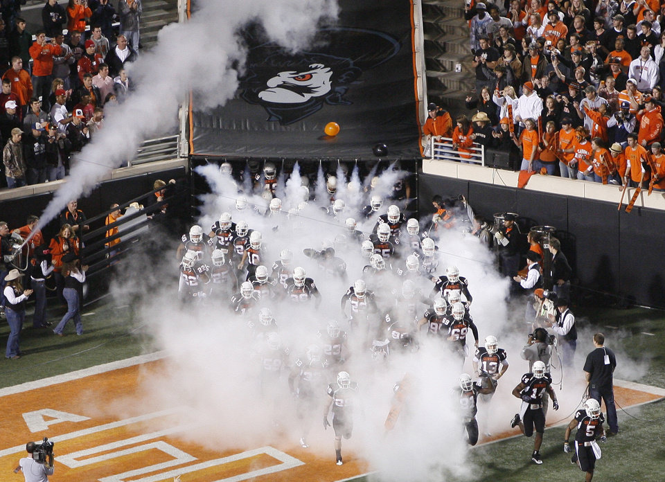 Photo - The OSU team takes the field before the college football game between Oklahoma State University (OSU) and the University of Colorado (CU) at Boone Pickens Stadium in Stillwater, Okla., Thursday, Nov. 19, 2009. Photo by Bryan Terry, The Oklahoman