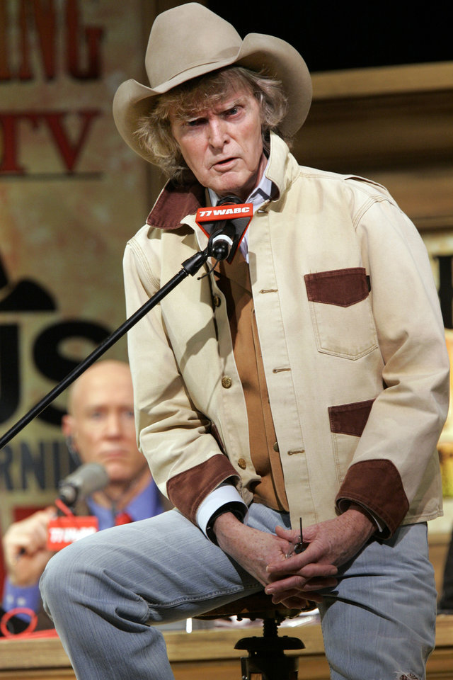 Photo - Producer Bernard McGuirk, right, listens as radio personality Don Imus addresses the audience at New York's Town Hall during his return to radio Monday morning Dec. 3, 2007. Imus returned to the airwaves Monday eight months after he was fired for a racially charged remark about the Rutgers women's basketball team.  (AP Photo/Richard Drew) ORG XMIT: NYRD106