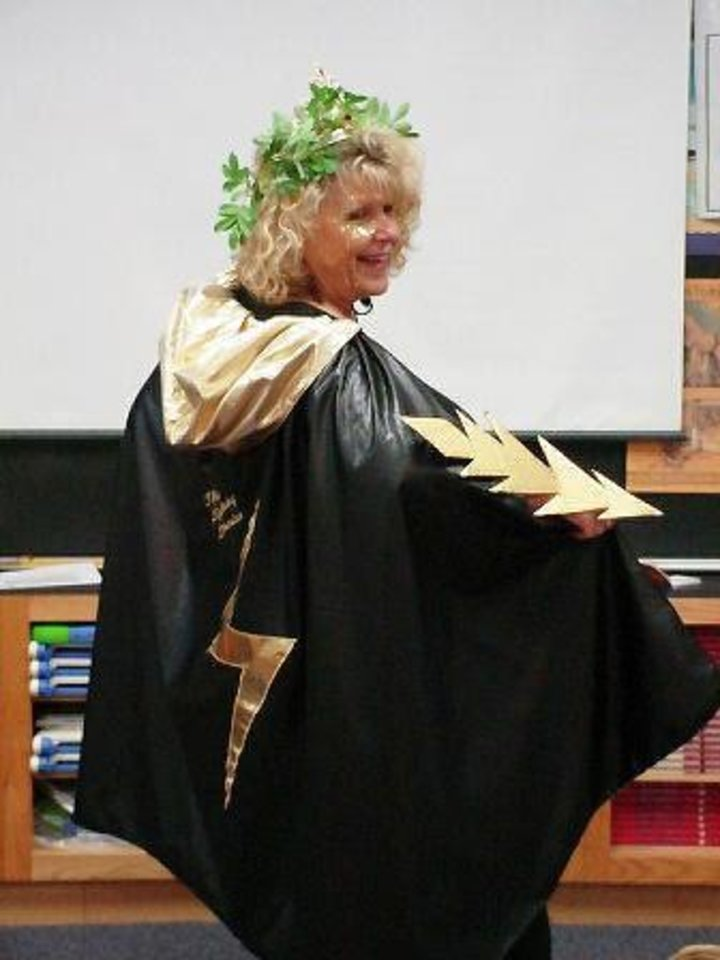 Photo - Clegern Elementary librarian Sherry Park, who will soon retire, dresses as a bolt of lightning to inspire interest in Greek mythology among her students. PHOTO PROVIDED