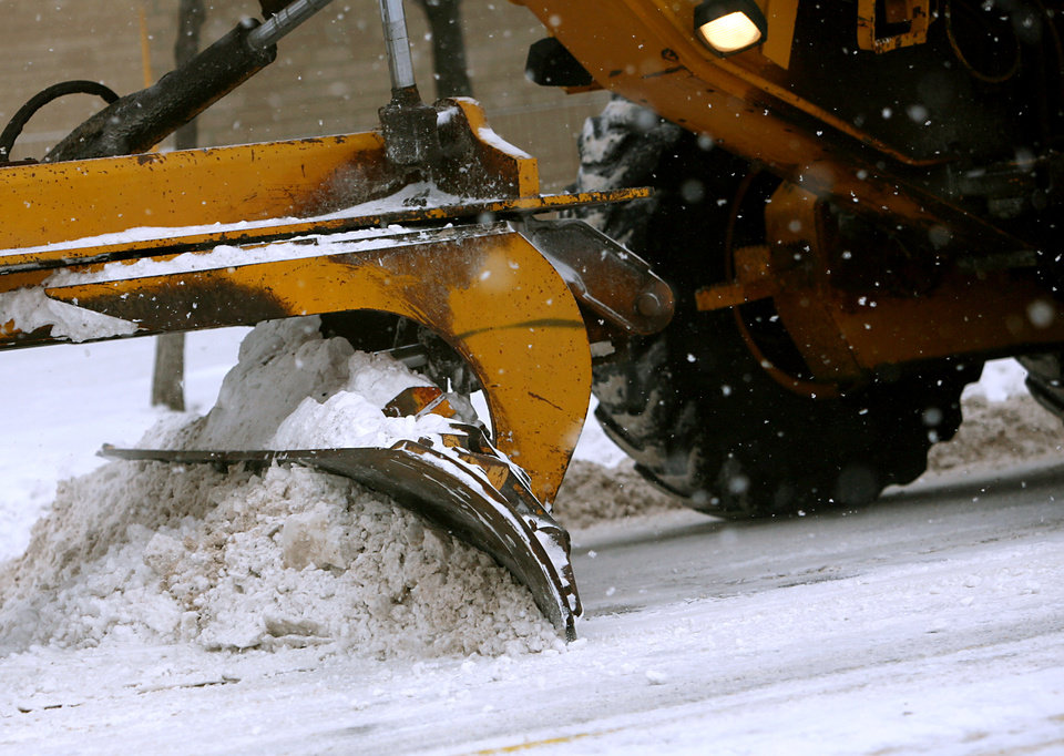 Photo - Heavy equipment pushes snow off of Penn near Britton during a snow storm in Oklahoma City on Wednesday, Feb. 9, 2011. Photo by John Clanton, The Oklahoman