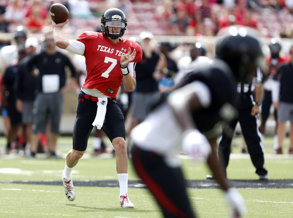 Photo - Texas Tech's Davis Webb (7) throws a pass during a spring NCAA college football game Saturday, April 12, 2014, in Lubbock, Texas. (AP Photo/The Avalanche-Journal, Tori Eichberger)