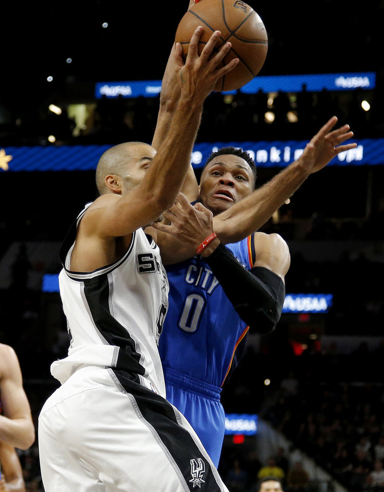 Photo - Oklahoma City's Russell Westbrook (0) fouls San Antonio's Tony Parker (9) during Game 2 of the second-round series between the Oklahoma City Thunder and the San Antonio Spurs in the NBA playoffs at the AT&T Center in San Antonio, Monday, May 2, 2016. Oklahoma City won 98-97. Photo by Bryan Terry, The Oklahoman