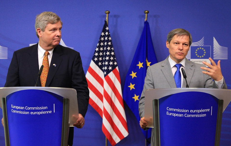 Photo - European Commissioner for Agriculture Dacian Ciolos, right, and U.S. Secretary of Agriculture Tom Vilsack, address the media at the European Commission headquarters in Brussels, Tuesday, June 17, 2014. (AP Photo/Yves Logghe)
