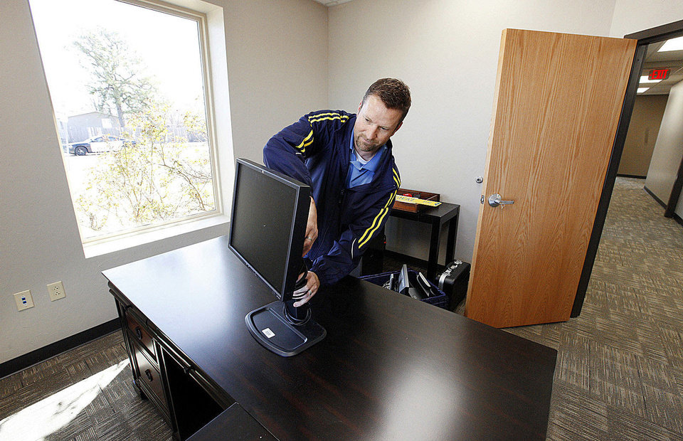 Steve Hudson, Edmond�s information technology infrastructure manager, moves into his new office at the city�s permanent information technology building. PHOTOs BY PAUL B. SOUTHERLAND, THE OKLAHOMAN