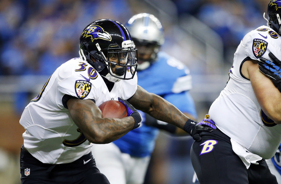 Photo - Baltimore Ravens running back Bernard Pierce (30) runs during the first quarter of an NFL football game against the Detroit Lions in Detroit, Monday, Dec. 16, 2013. (AP Photo/Rick Osentoski)