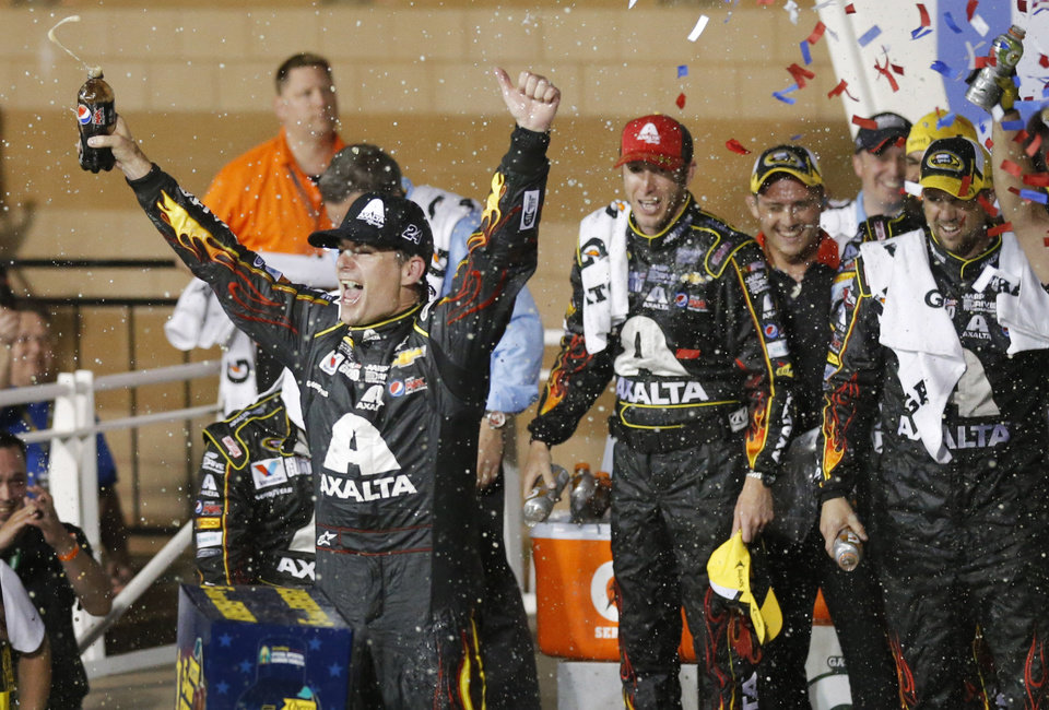 Photo - NASCAR driver Jeff Gordon celebrates in victory lane after winning the Sprint Cup Series auto race at Kansas Speedway in Kansas City, Kan., Saturday, May 10, 2014. (AP Photo/Orlin Wagner)