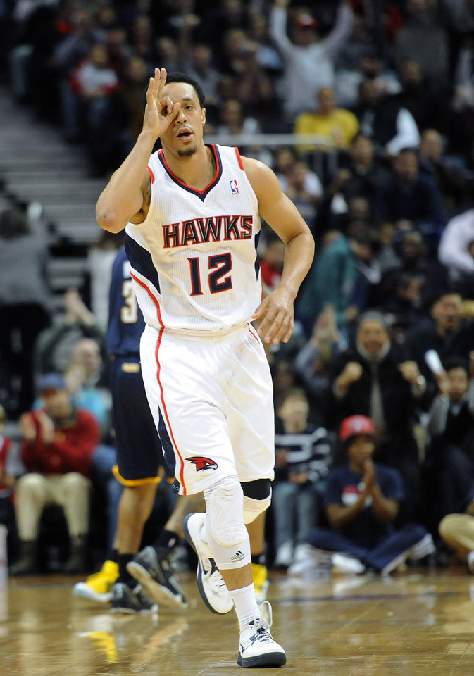 Photo - Atlanta Hawks guard John Jenkins (12) reacts after making a three-point basket against the Indiana Pacers during the first half of an NBA basketball game on Saturday, Dec. 29, 2012, at Philips Arena in Atlanta. (AP Photo/John Amis)