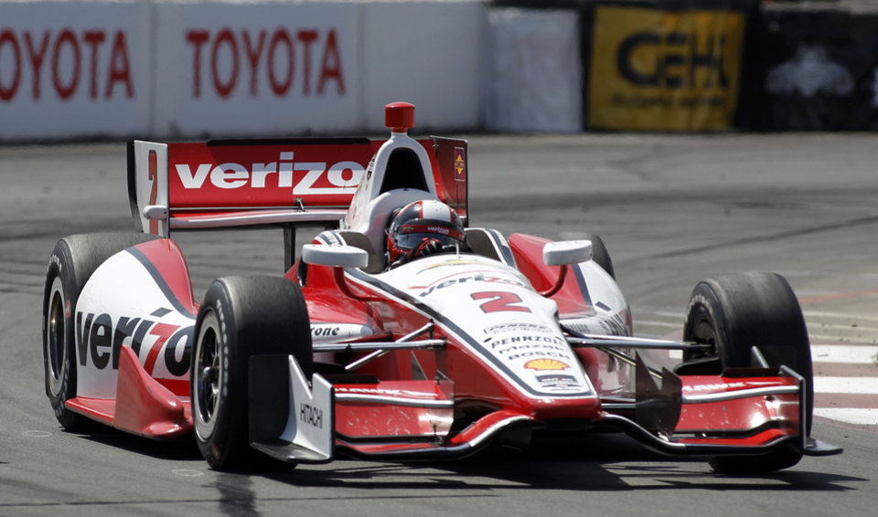 Photo - In this April 13, 2014, photo, Juan Pablo Montoya, of Colombia, drives through a turn in the IndyCar Grand Prix of Long Beach auto race in Long Beach, Calif. Montoya wants a strong encore after his fourth-place finish at Long Beach--his best in a test, practice or qualifying since jumping from NASCAR to IndyCar. (AP Photo/Alex Gallardo)