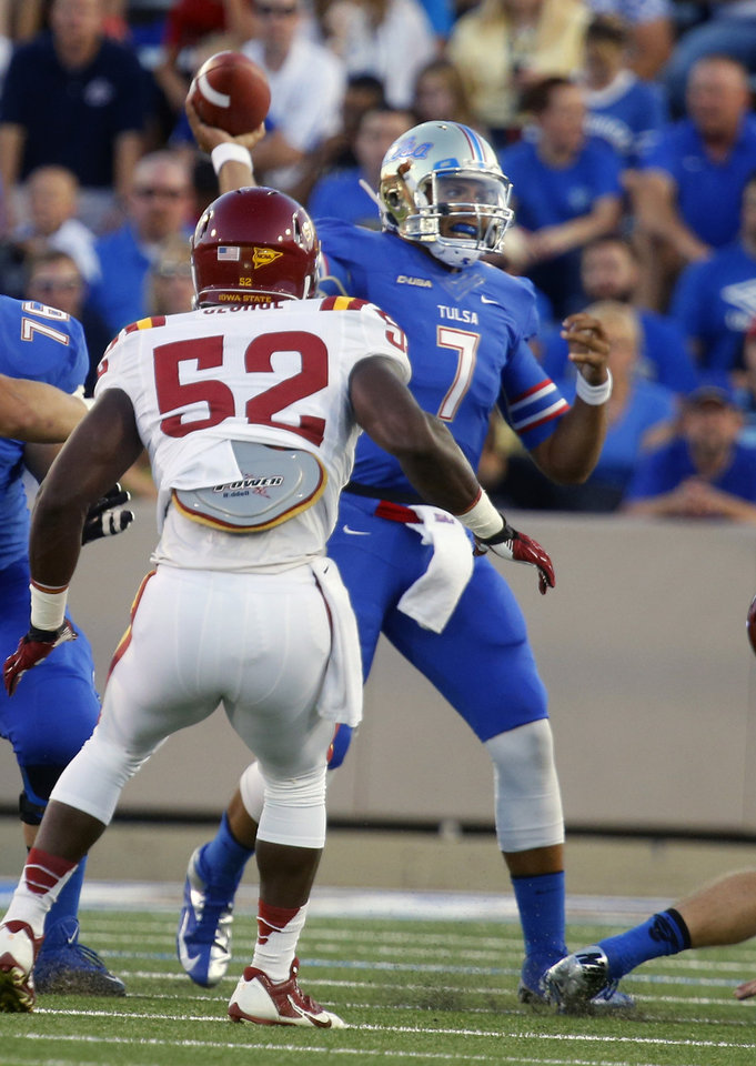 Photo - Tulsa's Cody Green (7) is pressured by Iowa State's Jeremiah George during the first half of an NCAA college football game, Thursday, Sept. 26, 2013 in Tulsa, Okla. (AP Photo/Tulsa World,  Tom Gilbert)  ONLINE OUT; TV OUT; TULSA OUT