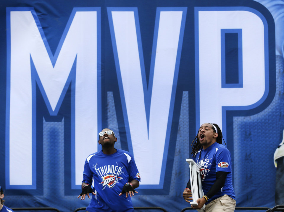 Photo - Oklahoma City Thunder Storm Chasers J.P. Davis, left and Terrance Briscoe   perform  during a rally for Kevin Durant's MVP announcement at the Thunder Community Events Center in Edmond, Tuesday May 06, 2014. Photo By Steve Gooch, The Oklahoman
