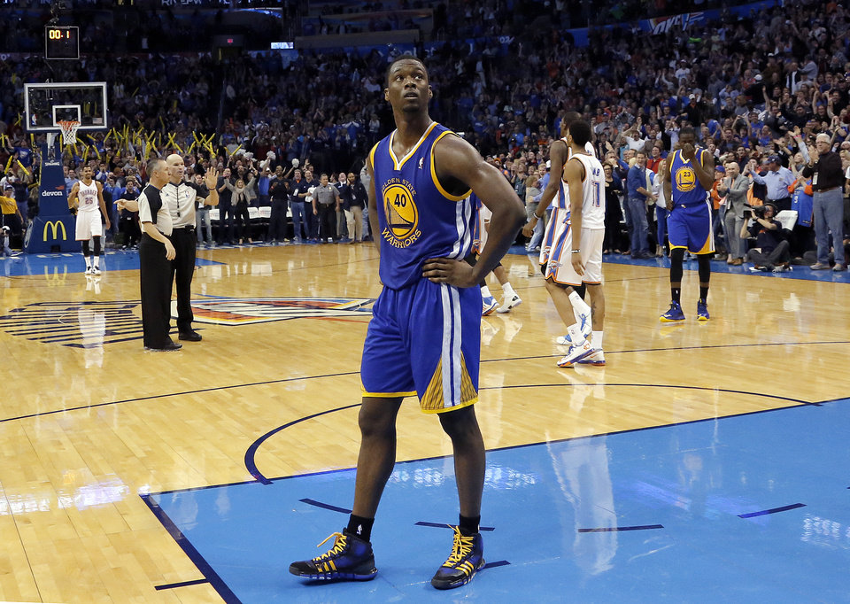 Photo - Golden State's Harrison Barnes (40) walks to the bench after Russell Westbrook's game-winning three-pointer during overtime in the NBA game between the Oklahoma City Thunder and the Golden State Warriors at the Chesapeake Energy Arena, Friday, Nov. 29, 2013. Photo by Sarah Phipps, The Oklahoman