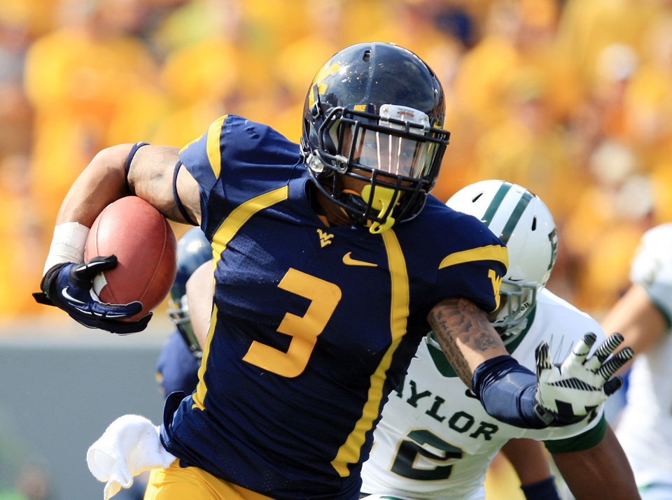 West Virginia receiver Stedman Bailey (3) carries the ball after a catch during their NCAA college football game against Baylor in Morgantown, W.Va., Saturday, Sept. 29, 2012. (AP Photo/Christopher Jackson)   ORG XMIT: WVCJ114