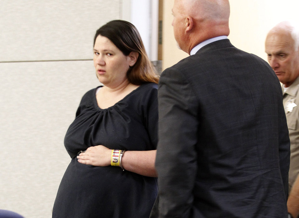 FILE - In this June 27, 2012 file photo, Dorothy Maraglino attends a hearing at San Diego County Superior Court in Vista, Calif. A preliminary hearing began Monday, March 11, 2013 for Maraglino, Jessica Lynn Lopez and Marine Sgt. Louis Ray Perez on charges that they kidnapped the wife of a Camp Pendleton Marine, tortured her during sadomasochistic sex and killed her. The three have pleaded not guilty to murdering 22-year-old Brittany Killgore, who vanished last year while her estranged husband was serving in Afghanistan. (AP Photo/Lenny Ignelzi, File)
