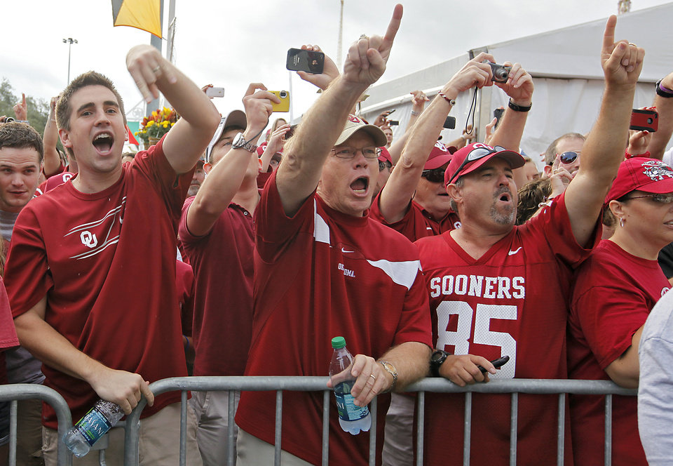 Oklahoma fans cheer on their team as the Sooners\' team busses arrive for the Red River Rivalry college football game between the University of Oklahoma Sooners (OU) and the University of Texas Longhorns (UT) at the Cotton Bowl in Dallas, Saturday, Oct. 8, 2011. Photo by Chris Landsberger, The Oklahoman