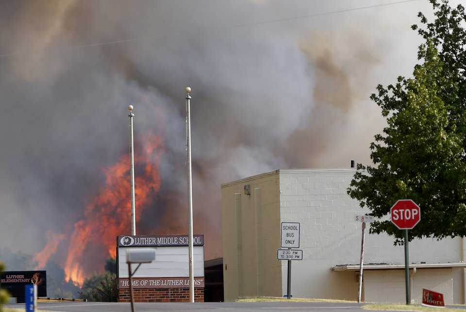 Photo - A fire burns near the Luther Middle School in Luther, Okla.,  during a large wildfire Friday, Aug. 3, 2012. Photo by Sarah Phipps, The Oklahoman