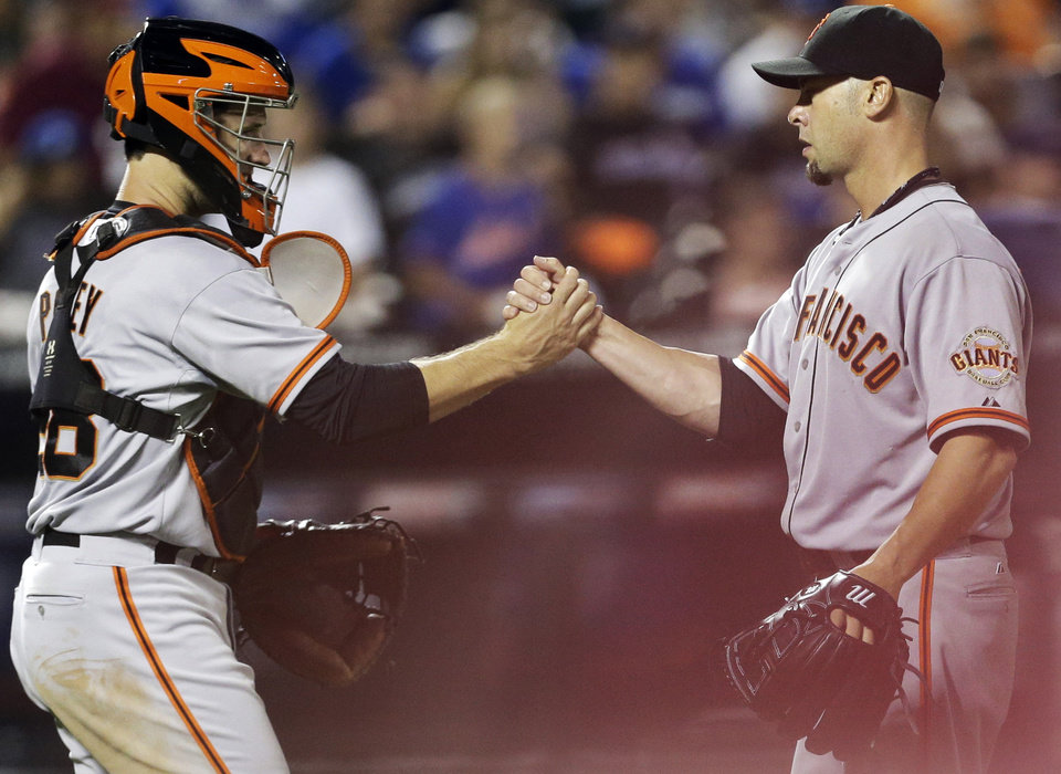 Photo - San Francisco Giants starting pitcher Ryan Vogelsong, right, celebrates with catcher Buster Posey after a baseball game against the New York Mets on Friday, Aug. 1, 2014, in New York. The Gaints won 5-1. (AP Photo/Frank Franklin II)