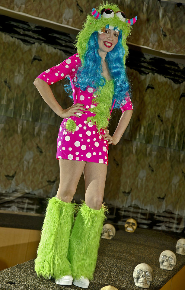 Photo - This funky go-go costume is available in women's, teens and toddler sizes. Costume sold at Party Galaxy. Makeup by Sharon Tabb, The Makeup Room Agency. Photo by Chris Landsberger, The Oklahoman.  CHRIS LANDSBERGER