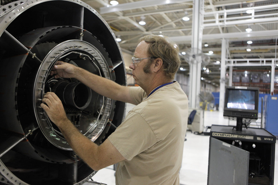 TINKER MAINTENANCE FACILITIES: Richard Law inspects an aircraft engine core with a scope at Tinker Air Force Base in Midwest City, Tuesday, July 3, 2012.  The Oklahoman Archives