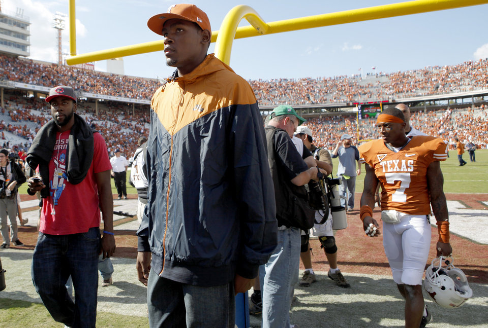 Photo - Oklahoma City Thunder NBA basketball player Kevin Durant walks off the field after the Red River Rivalry college football game between the University of Oklahoma Sooners (OU) and the University of Texas Longhorns (UT) at the Cotton Bowl in Dallas, Texas, Saturday, Oct. 17, 2009. Photo by Bryan Terry, The Oklahoman ORG XMIT: KOD