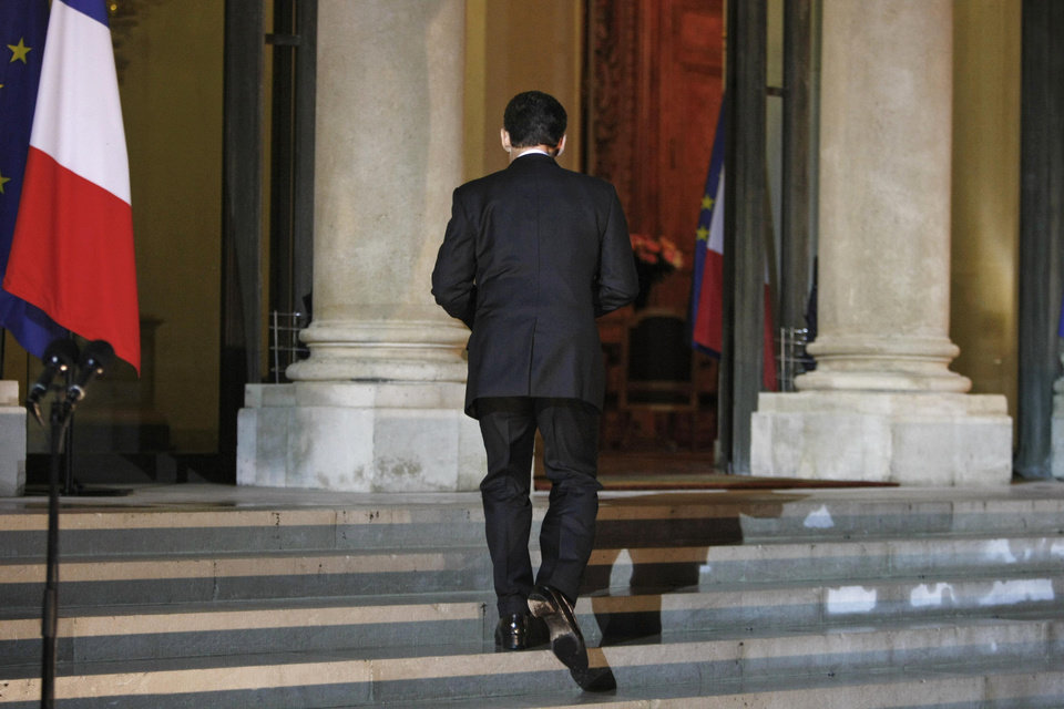 French President Nicolas Sarkozy returns to his office after he addresses the media, at the Elysee Palace, in Paris, Tuesday Nov. 1, 2011. Sarkozy defended the hard-fought European bailout plan for Greece as the only way possible to resolve that nation\'s debt crisis, bemoaning the bombshell Greek decision to put the plan to a referendum. (AP Photo/Thibault Camus) ORG XMIT: XTC107