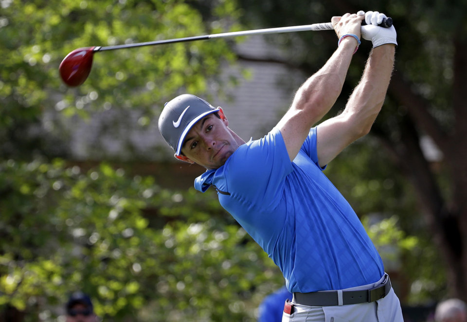 Photo - Rory McIlroy, of Northern Ireland, watches his tee shot on the 10th hole during the third round of the PGA Championship golf tournament at Valhalla Golf Club on Saturday, Aug. 9, 2014, in Louisville, Ky. (AP Photo/David J. Phillip)