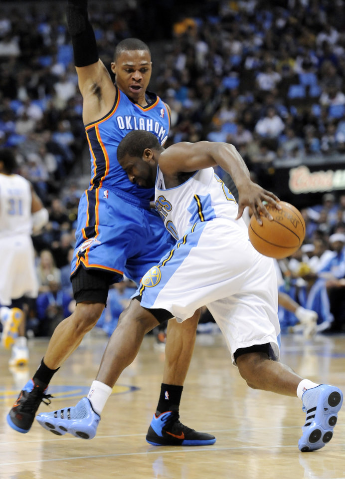Denver Nuggets guard Raymond Felton (20) is fouled by Oklahoma City Thunder guard Russell Westbrook (0) during the first half in game 4 of a first-round NBA basketball playoff series Monday, April 25, 2011, in Denver. (AP Photo/Jack Dempsey)