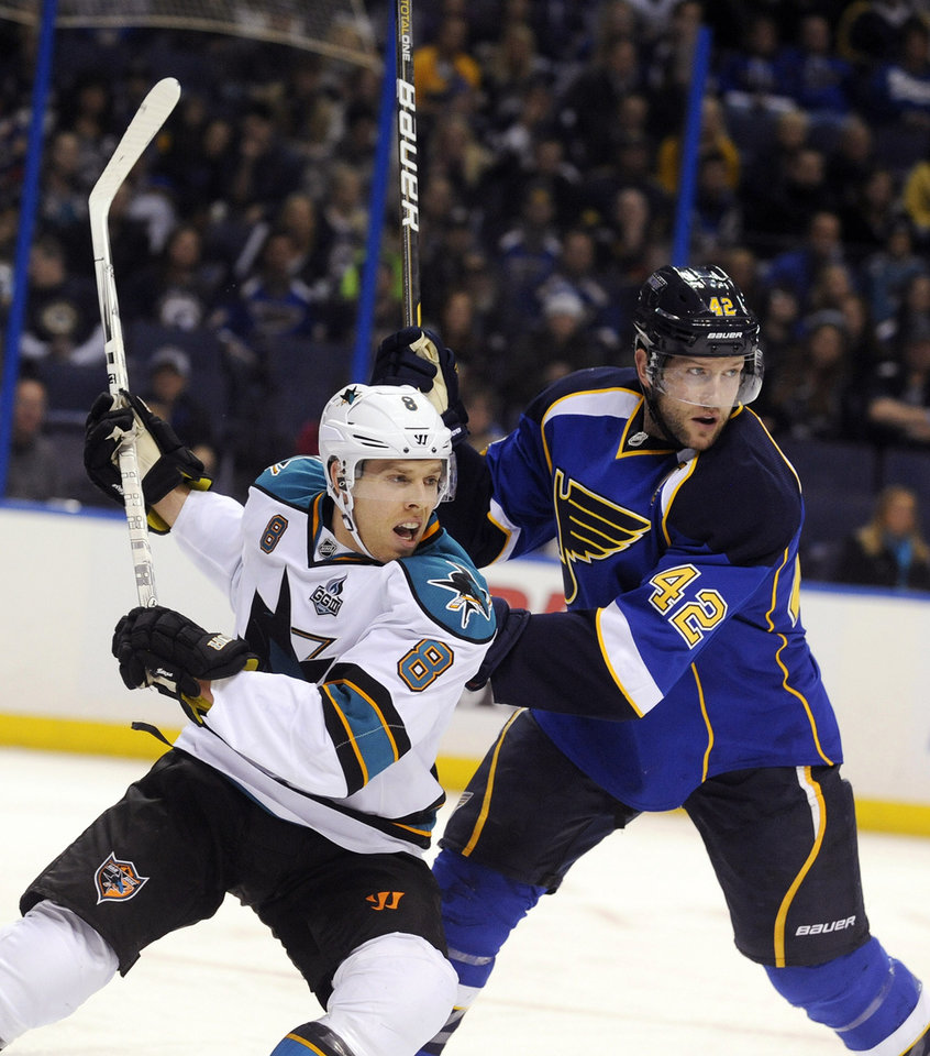 St. Louis Blues' David Backes (42) pushes off San Jose Sharks' Joe Pavelski (8) in the first period of an NHL hockey game, Tuesday, Feb. 19, 2013, in St. Louis. (AP Photo/Bill Boyce)