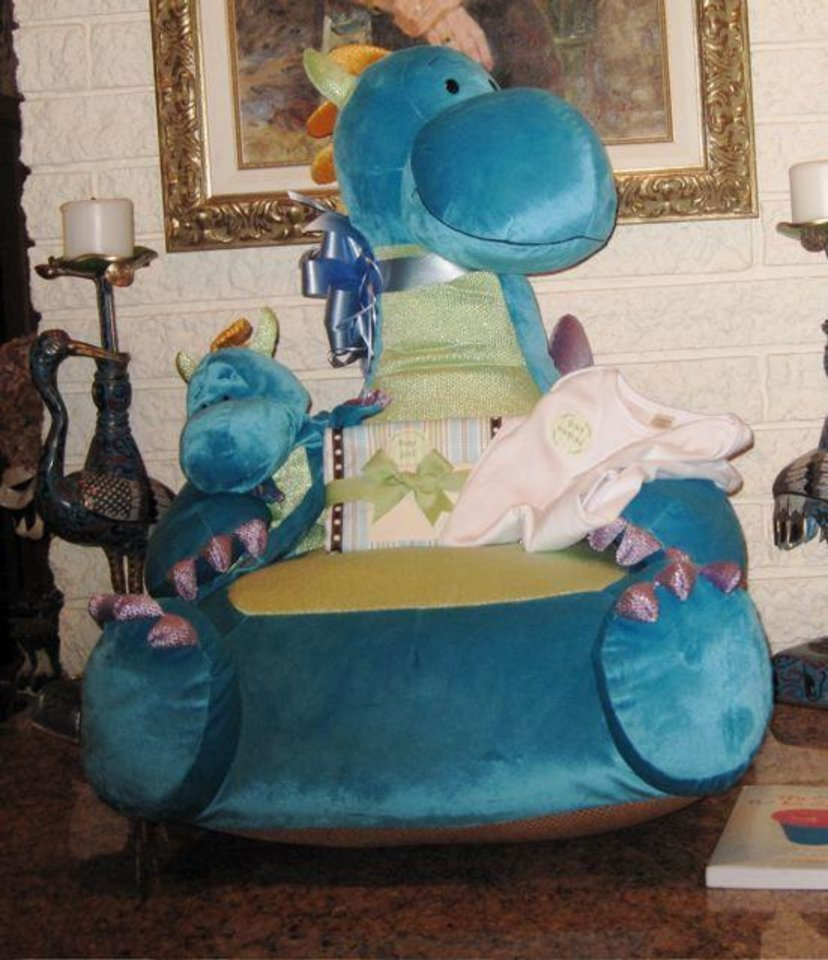 COMING SOON....A toy dragon chair, puppet and tee shirt were among  the gifts for the baby boy due in April. (Photo by Helen Ford Wallace).