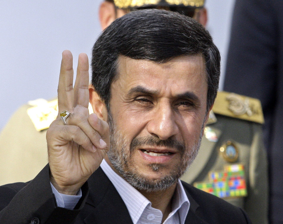 Photo -   FILE - In this Sept. 1, 2012 file photo, Iranian President Mahmoud Ahmadinejad flashes a victory sign in Tehran, Iran. With the Iraq war over and Afghanistan winding down, Iran is the most likely place for a new U.S. military conflict. Despite unprecedented global sanctions, Iran's nuclear program is advancing. The United States and other Western nations fear the Islamic republic is determined to develop nuclear weapons and fundamentally reshape the balance of power in the Middle East, while posing a grave threat to Israel. Iran insists its program is solely designed for peaceful energy and medical research purposes. (AP Photo/Vahid Salemi, File)