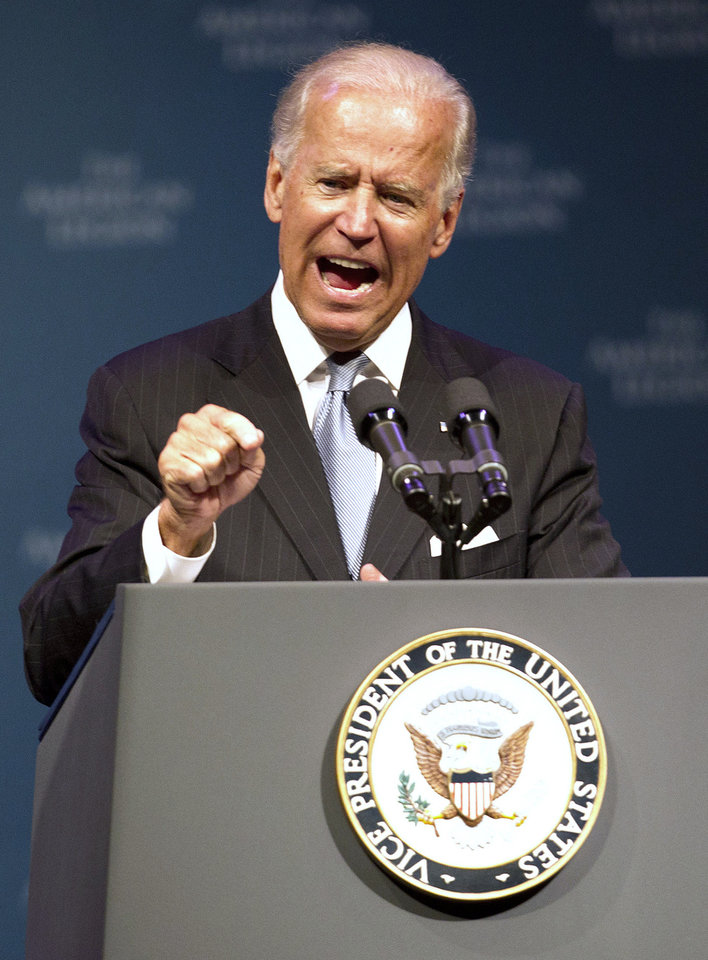 Photo - Vice President Joe Biden speaks during The American Legion's annual convention at the George R. Brown Convention Center in Houston on Tuesday, Aug. 27, 2013. Biden says there is no doubt that Syrian President Bashar Assad's government is responsible for the heinous use of chemical weapons. Biden's comments make him the highest-ranking U.S. official to say the Syrian regime is the culprit in a large-scale chemical weapons attack on Aug. 21. (AP Photo/Houston Chronicle, Johnny Hanson) MANDATORY CREDIT