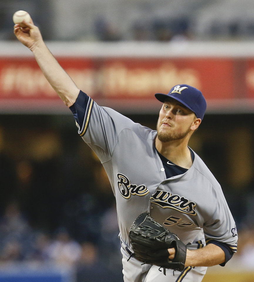 Photo - Milwaukee Brewers starting pitcher Jimmy Nelson pitches to the San Diego Padres in the first inning of a baseball game Tuesday, Aug. 26, 2014, in San Diego. (AP Photo/Lenny Ignelzi)