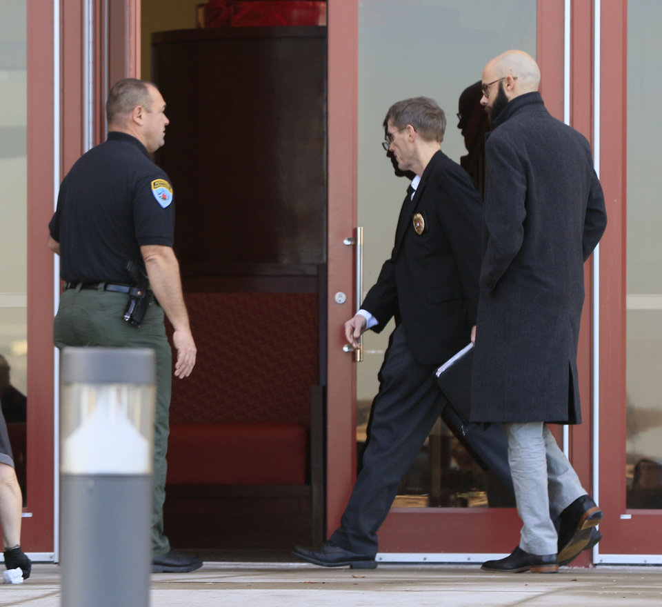 Photo -  Tribal Police Chief James Collard enters the casino as police investigate a  shooting at the Grand Casino in Shawnee. [Photo by Paul Hellstern, The Oklahoman]