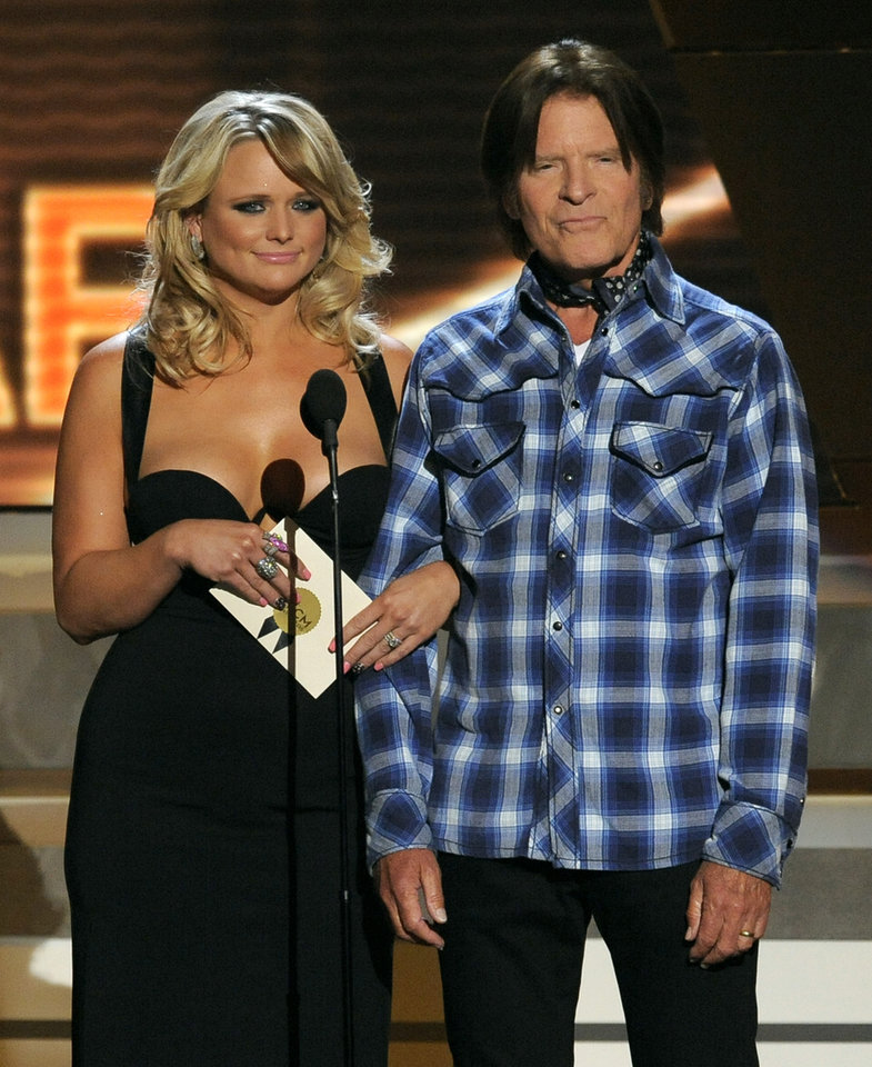 Miranda Lambert, left, and John Fogerty present the award for album of the year at the 48th Annual Academy of Country Music Awards at the MGM Grand Garden Arena in Las Vegas on Sunday, April 7, 2013. (Photo by Chris Pizzello/Invision/AP) ORG XMIT: NVPM258