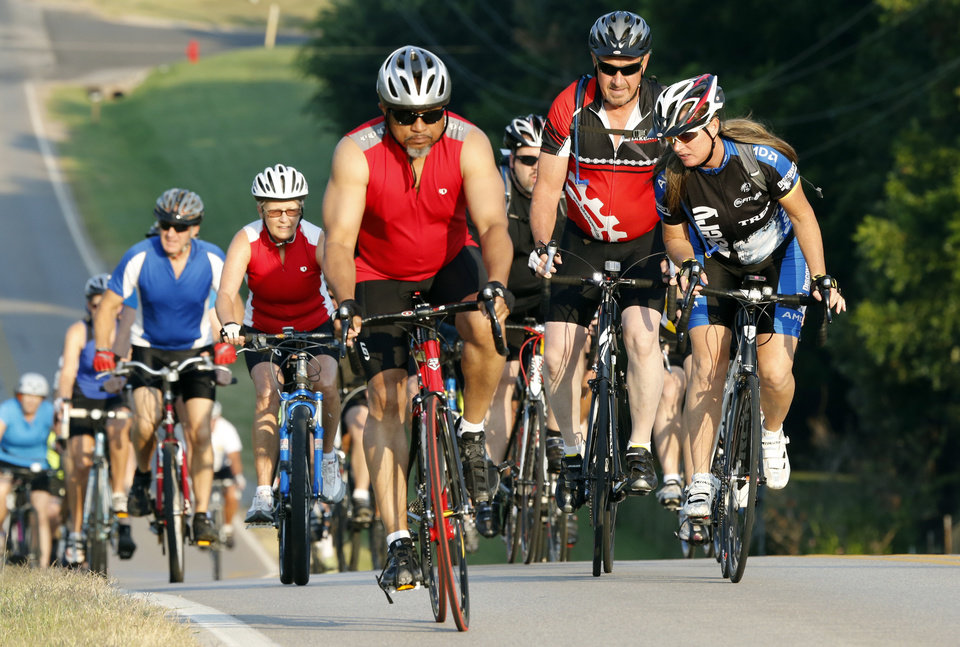 Photo -  Riders head east on Robinson Street during last year's Norman Conquest bicycle ride that benefits the J.D. McCarty Center. PHOTO BY STEVE SISNEY, THE OKLAHOMAN ARCHIVES   STEVE SISNEY -