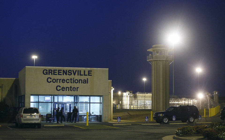 FILE In this Thursday Sept. 23, 2010 file photo prison guards mill outside the entrance to the Greensville Correctional Center in Jarratt, Va. Robert Gleason Jr.  is scheduled to be executed at 9 p.m., Wednesday, Jan. 16, 2013 at the prison.  (AP Photo/Steve Helber)