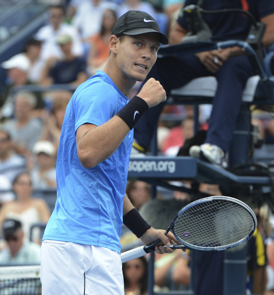 Photo -   Czech Republic's Tomas Berdych reacts during his match against Spain's Nicolas Almagro in the fourth round of play at the 2012 US Open tennis tournament, Monday, Sept. 3, 2012, in New York. (AP Photo/Henny Ray Abrams)