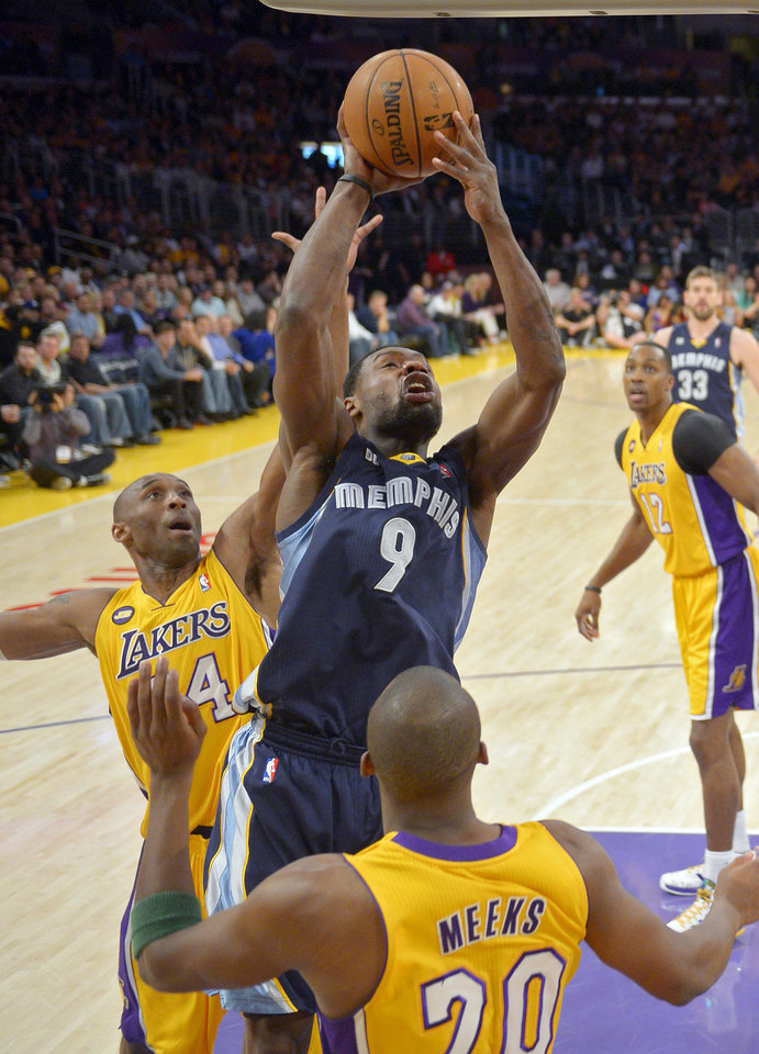 Memphis Grizzlies guard Tony Allen, center puts up a shot as Los Angeles Lakers guard Kobe Bryant, left, defends along with guard Jodie Meeks during the first half of their NBA basketball game, Friday, April 5, 2013, in Los Angeles. (AP Photo/Mark J. Terrill)