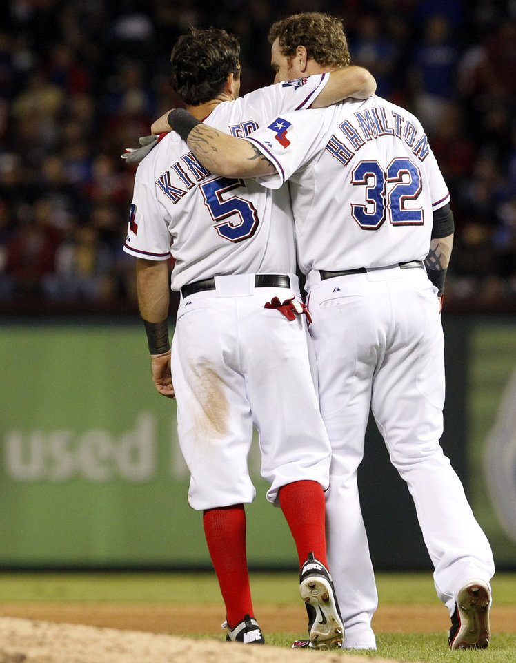 Photo -   Texas Rangers second baseman Ian Kinsler (5) and center fielder Josh Hamilton (32) embrace during the ninth inning of an American League wild-card playoff baseball game against the Baltimore Orioles on Friday, Oct. 5, 2012, in Arlington, Texas. Baltimore won 5-1. (AP Photo/LM Otero)