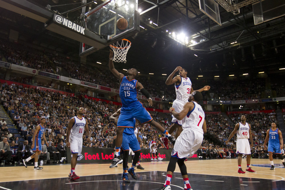 Oklahoma City Thunder's Reggie Jackson, centre left, takes a shot during his team's NBA preseason basketball game against the Philadelphia 76ers at the Phones 4u Arena in Manchester, England, Tuesday, Oct. 8, 2013. (AP Photo/Jon Super) ORG XMIT: MJS110