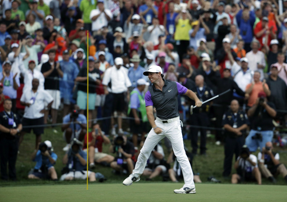 Photo - Rory McIlroy, of Northern Ireland, celebrates after winning the PGA Championship golf tournament at Valhalla Golf Club on Sunday, Aug. 10, 2014, in Louisville, Ky. (AP Photo/Jeff Roberson)