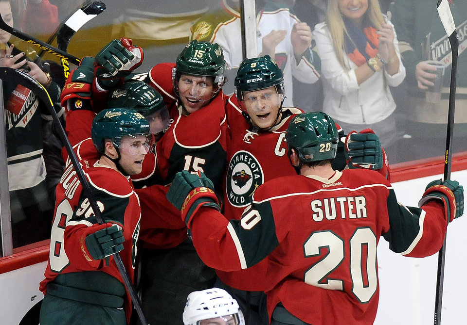 Minnesota Wild\'s Dany Heatly (15), center, is surrounded by teammates, from left, Pierre-Marc Bouchard (96), Zach Parise (11}, Mikko Koivu (9) and Ryan Suter (20) as they celebrate his second period goal against the Colorado Avalanche during an NHL hockey game in St. Paul, Minn. on Saturday, Jan. 19, 2013. (AP Photo/ St. Paul Pioneer Press, Sherri LaRose-Chiglo)
