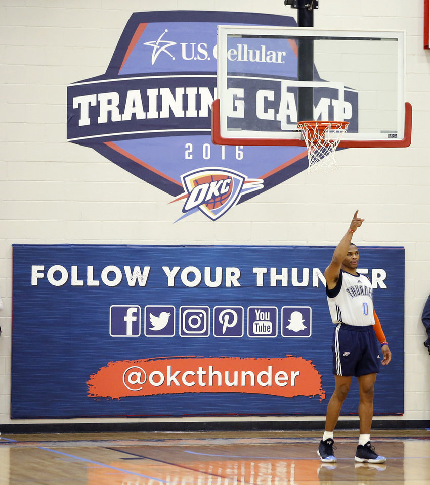 Photo - Oklahoma CIty's Russell Westbrook points before the start of the Thunder's annual Blue and White Scrimmage at John Marshall Mid-High School in Oklahoma City, Tuesday, Sept. 27, 2016. Photo by Bryan Terry, The Oklahoman