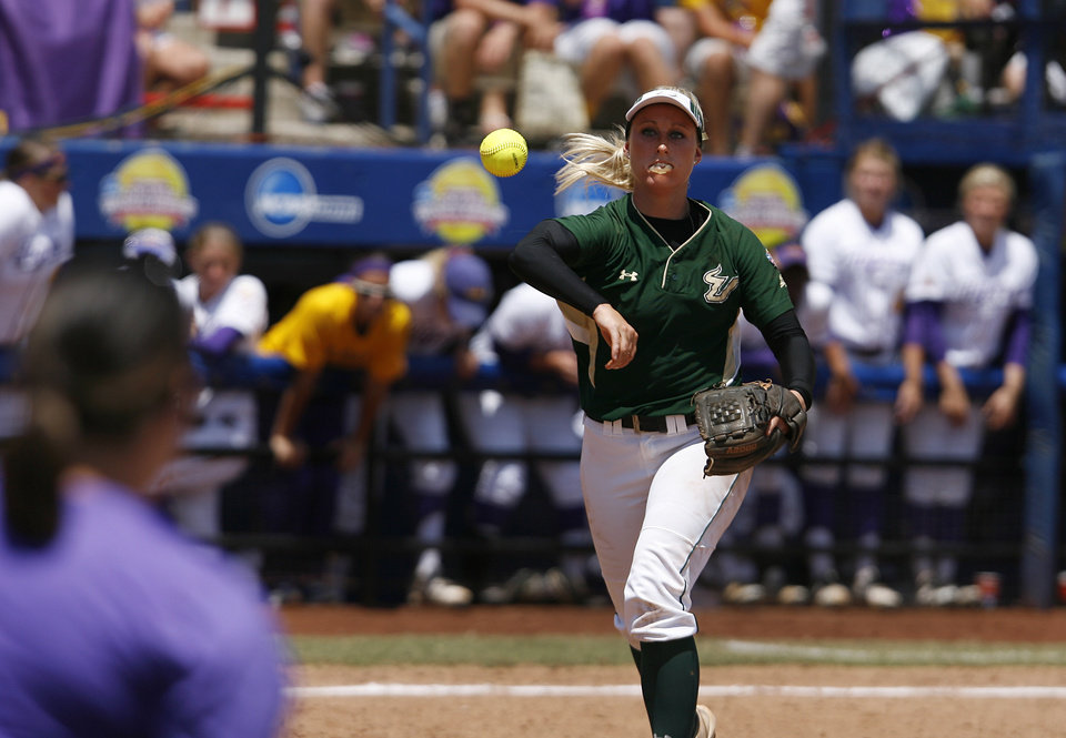 USF's Jessica Mouse (14) throws a ball to first base during a Women's College World Series game between Louisiana State University and the University of South Florida at ASA Hall of Fame Stadium in Oklahoma City, Saturday, June 2, 2012.  Photo by Garett Fisbeck, The Oklahoman