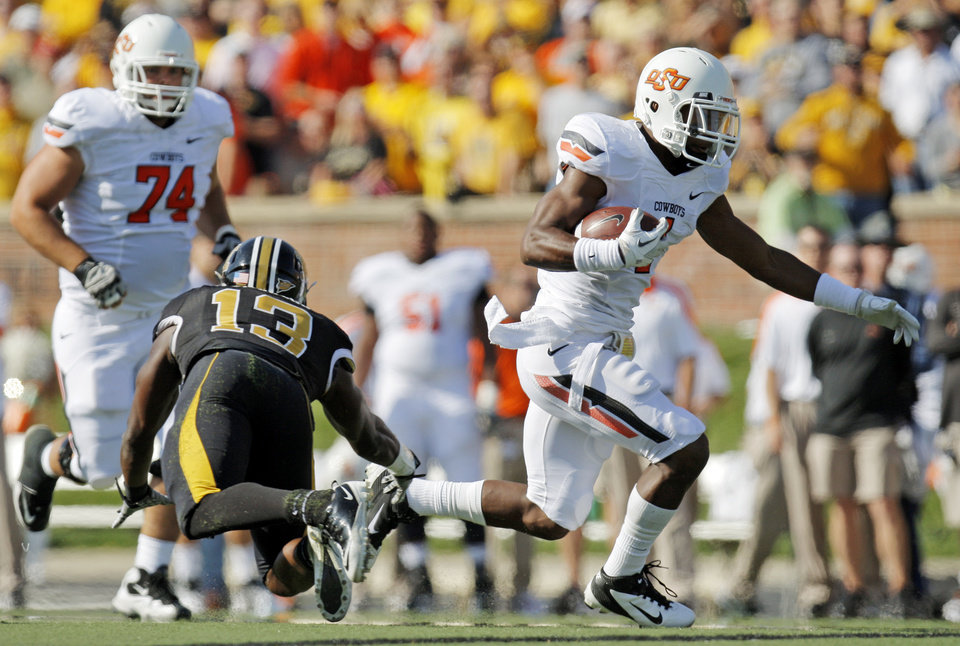Photo - Oklahoma State's Joseph Randle (1) breaks away from Missouri's Kenji Jackson (13) in front of Oklahoma State's Grant Garner (74) in the first quarter during a college football game between the Oklahoma State University Cowboys (OSU) and the University of Missouri Tigers (Mizzou) at Faurot Field in Columbia, Mo., Saturday, Oct. 22, 2011. Photo by Nate Billings, The Oklahoman