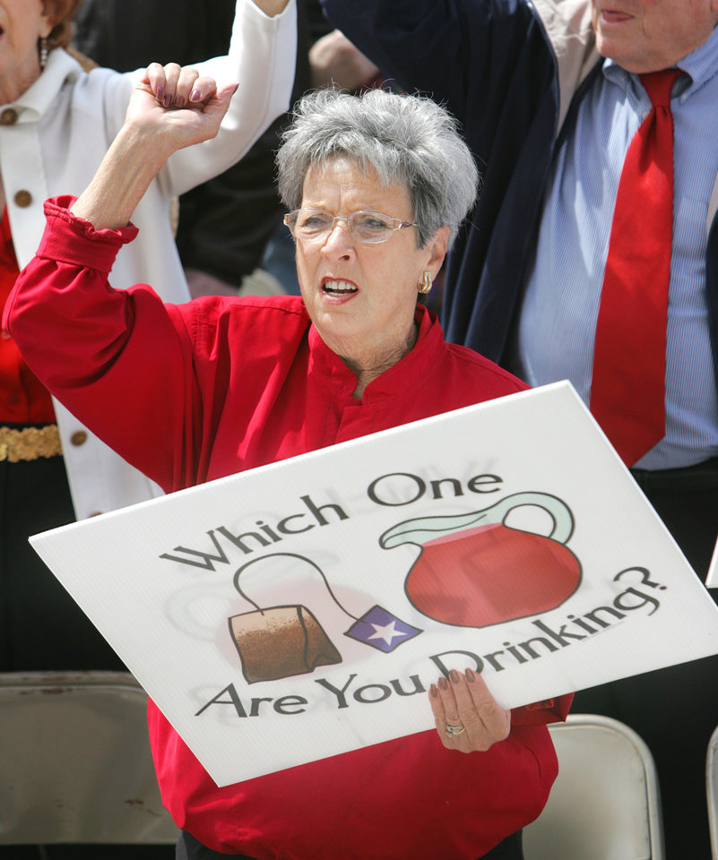Photo - JoAnne Lotspeich of Yukon, joins other Tax Day Protesters gather on the south steps of the State Capitol to protest government spending in Oklahoma City, Oklahoma April 15, 2009.  Photo by Steve Gooch, The Oklahoman