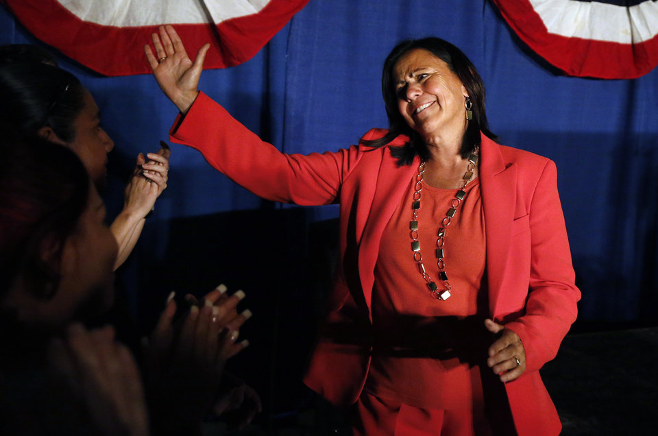 Photo - Democratic state Sen. Angela Giron waves to supporters as she gives her concession speech after she lost in a recall vote in Pueblo, Colo., Tuesday Sept. 10, 2013. Two Colorado state lawmakers who backed gun-control measures in the aftermath of the mass shootings in Colorado and Connecticut last year have been ousted in recall elections. (AP Photo/Brennan Linsley)