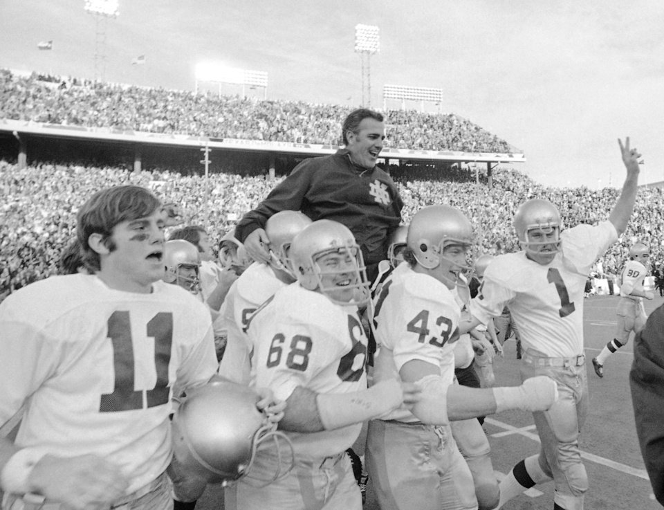 Photo - FILE - In this Jan. 1, 1971, file photo, Notre Dame coach Ara Parseghian is carried off the field by his victorious players after the Irish victory over Texas 24-11 in the Cotton Bowl NCAA college football game in Dallas. At a time when college football was generally considered the domain of eastern blue bloods, Notre Dame and Alabama were upstart teams that gave blue collar fans a chance to tweak the elite. About 90 years later, the Fighting Irish and Crimson Tide are the elite - two of college football's signature programs, set to play a national championship next Monday in Miami that could break records for television viewership. (AP Photo/File) ORG XMIT: NY160