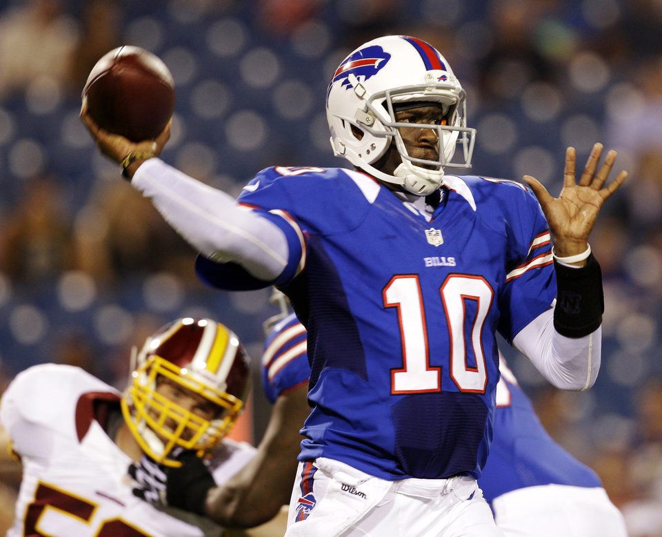 Photo -   Buffalo Bills quarterback Vince Young throws against the Washington Redskins during the second half of a preseason NFL football game in Orchard Park, N.Y., Thursday, Aug. 9, 2012. The Redskins won 7-6. (AP Photo/Gary Wiepert)